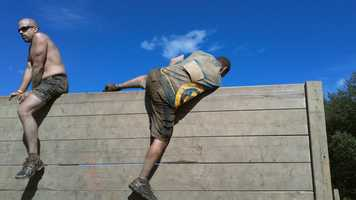 """Trent makes his ways up """"Berlin Walls,"""" a series of walls about 12 feet high."""