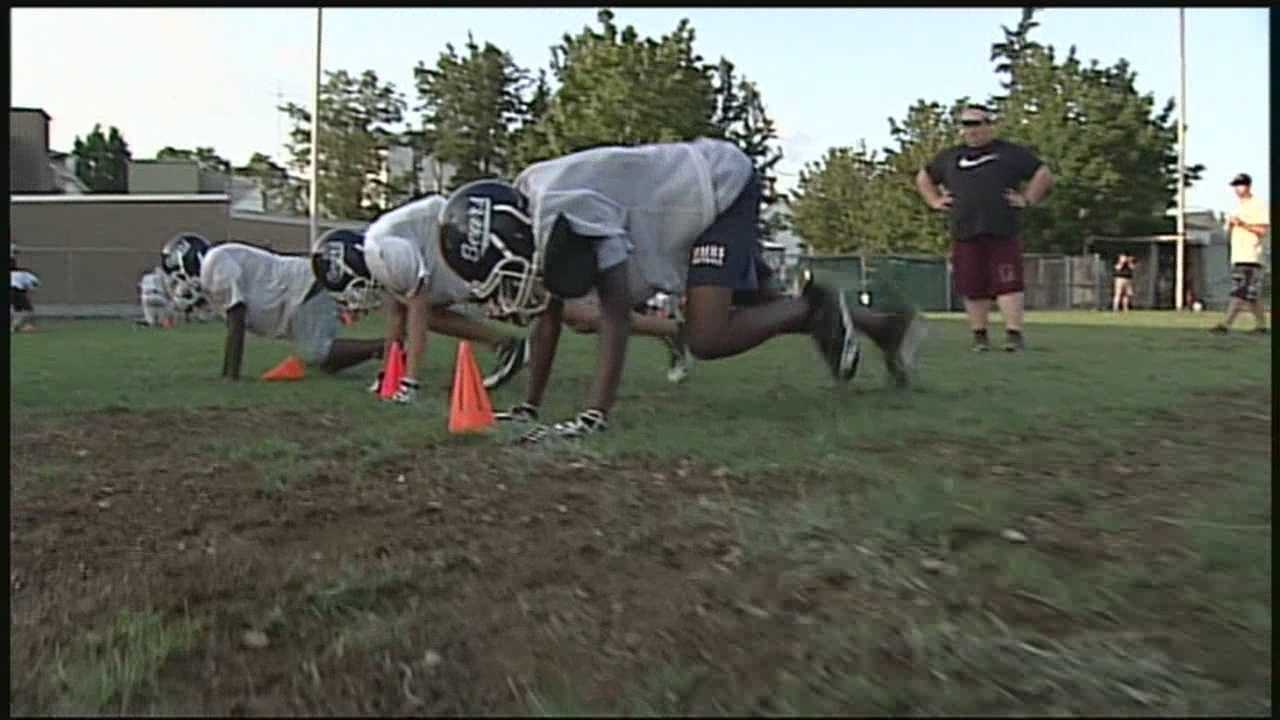Youth Football Works Out With Police