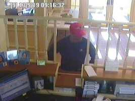 Police in Newton are searching for a bank robber who got away on a bicycle.