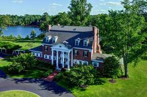 The property features a 10,000 sq. ft. Georgian revival mansion. It also includes several guest homes.