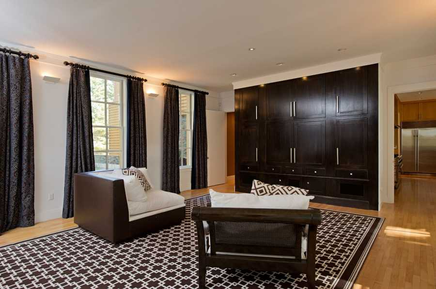 The home, which offers more than 11,000 square feet of living space, features a master bedroom suite with an oversized dressing room.