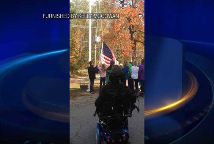 He presented the flag to the students as a way to show his appreciation.