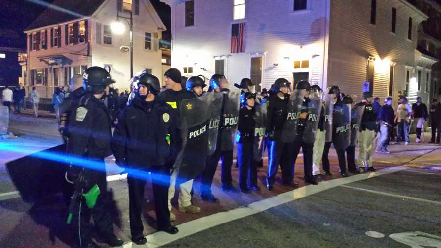 When police asked students to leave Main Street, campus officials said some people began throwing bottles.