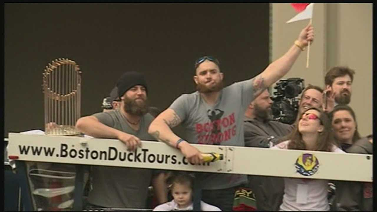 Sox players parade through Boston with World Series trophy