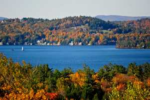 """Lake Sunapee, """"A pretty, hill-girt of water on which a small steamer plies."""""""