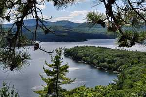 """Lake Winnipesaukee, """"The largest lake in New Hampshire is an irregularly shaped sleet of water surrounded by picturesque hills and dotted with innumerable islands."""""""