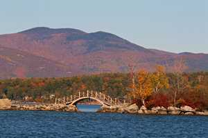 """Lake Winnipesaukee, """"The villages on the shores of the lake are favorite summer resorts, and are centers for numerous charming excursions."""""""