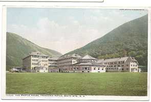 """The Profile House (Franconia Mts. $4-5). """"Perhaps the largest of the White Mountain hotels stands with its group of cottages at the north end of the Franconia Notch."""""""