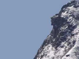 """Old Man of the Mountain, """"A curious freak of nature formed by three protruding and disconnected ledges, 1200 ft. above us, on the side of Cannon or Profile Mountain."""""""