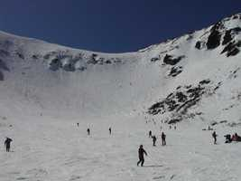 """Tuckerman's Ravine, """"Huge gorge on the southeast side of Mt. Washington and is enclosed by towering rocky walls 1000 ft. high.""""""""The Snow Arch, in the ravine proper, formed by the stream flowing under the huge masses of snow piled up here in the winter. The arch generally used to be seen until August."""""""