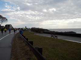 Mile 4: 1 Hello, Atlantic Ocean. Runners hit Route 1A at Wallis Sands.