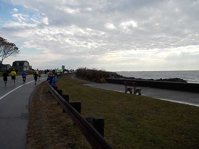 Mile 4: 1 Hello, Atlantic Ocean. Runners hit Route 1A at Wallis Sands.