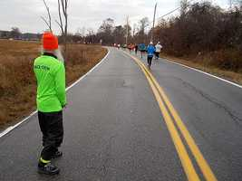 Mile 6: A big thank you to the great volunteers along the course. I just got sticky Gatorade hands on my new camera.