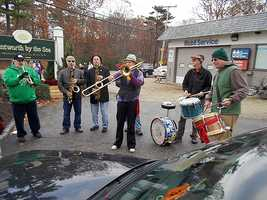 Mile 7.9: This awesome band provided some energy and a jump in runners' steps as they turned at the Mobil and headed toward the golf course.
