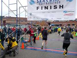 Mile 13.23: The finish line. Time to get your medal, grab a water and then in my case, cough up a lung.