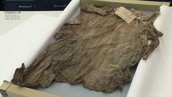 The T-shirt Lee Harvey Oswald was wearing when shot by Jack Ruby, as he was being walked through a crowd of reporters by Dallas Police.