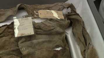 Oswald's shirt showing the bullet hole and an evidence tag.