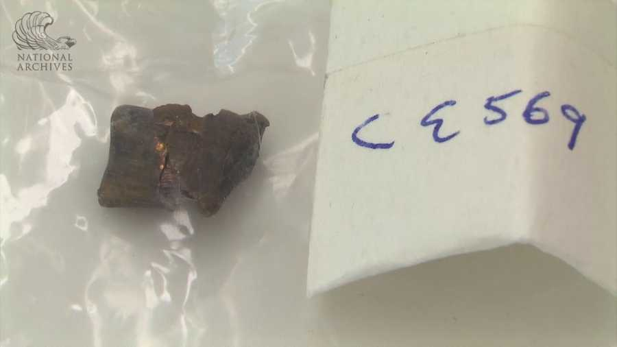 Fragment of base of bullet found in the front of the presidential limousine.