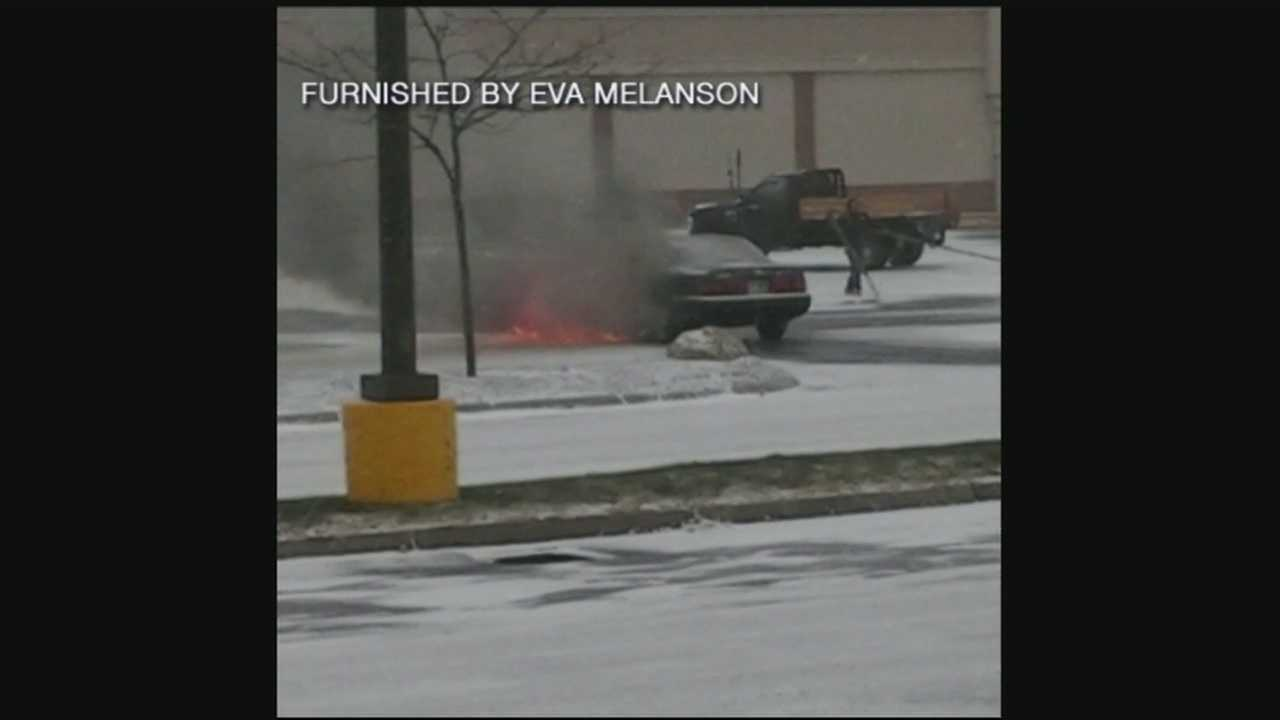 Officer uses cruiser to push burning car from pumps
