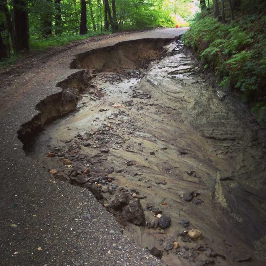 A flash flood in Lebanon wiped out several roads, including Slayton Hill Road, and forced evacuations.Read more: http://www.wmur.com/weather/more-than-30-roads-damaged-by-floods-in-lebanon/-/9859398/20832792/-/14hqon1z/-/index.html