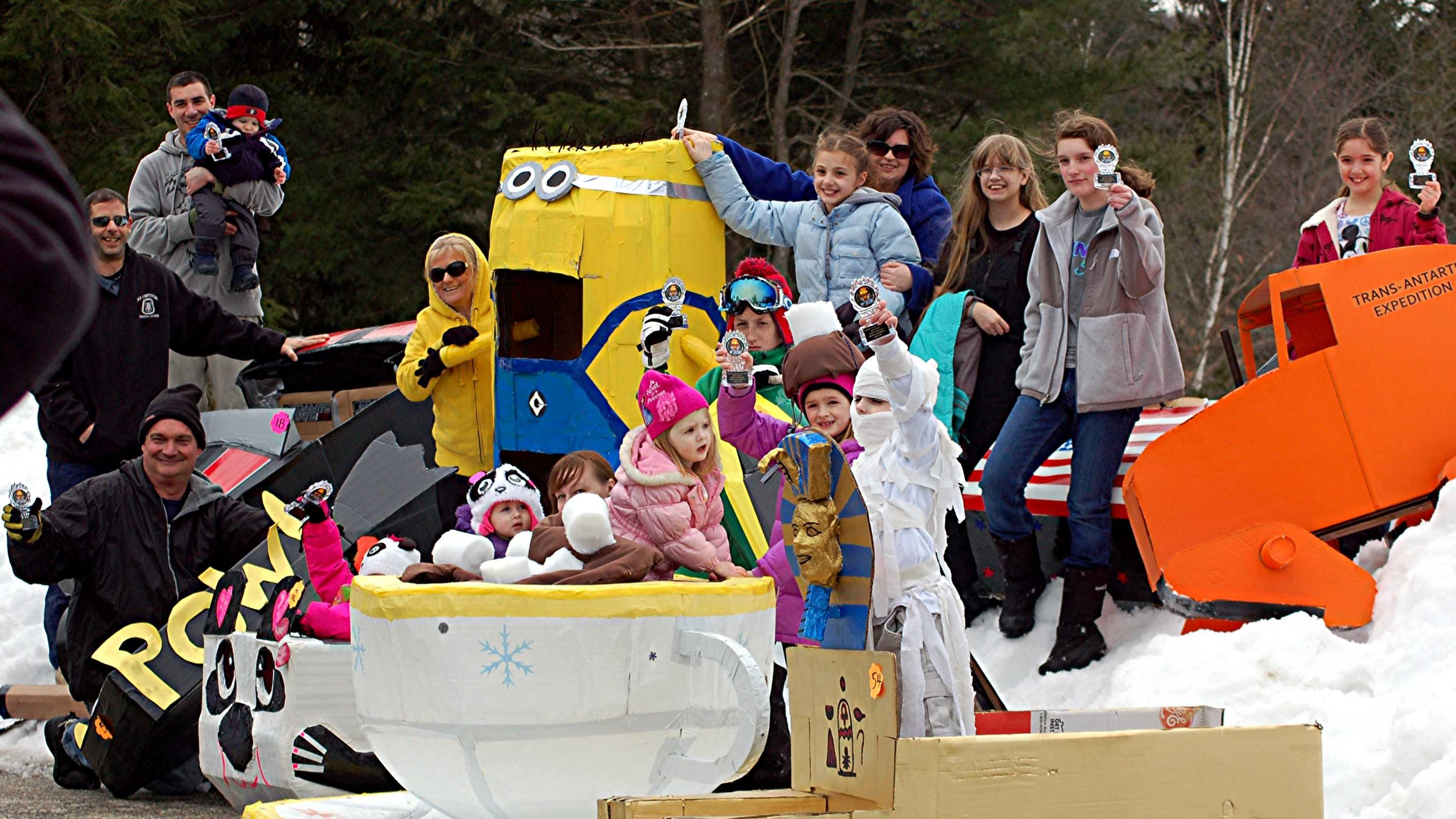A committee aiming to raise money for an amphitheater reached its goal Sunday during a cardboard sled race fundraiser.