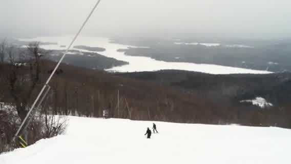 Skiers, snowboarders atop Mount Sunapee