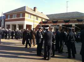 Firefighters gather before the funeral