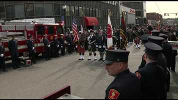 Hundreds of firefighters from around the county line the streets of Watertown.