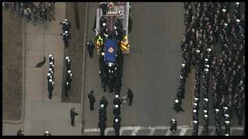 The body of Lt. Ed Walsh arrives outside St. Patrick's Church in Watertown.