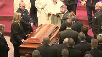 The casket with the body of Lt. Ed Walsh arrives inside St. Patrick's Church in Watertown.