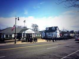Firefighters arrive for Kennedy's wake.