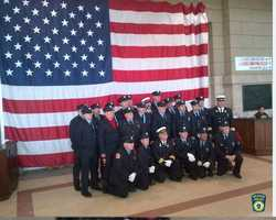Firefighters from all over New England gather at South Station waiting to board a train to the funeral.