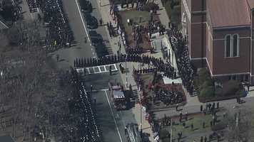 Hundreds of firefighters and first responders wait to enter Holy Name Church in West Roxbury for the funeral of Boston firefighter Michael Kennedy.