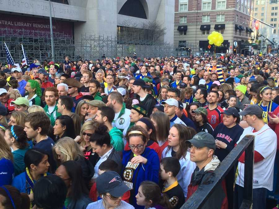 Thousands of people, including bombing survivors and first responders, lined the Boston Marathon finish line Saturday morning for an historic cover shoot for Sports Illustrated.
