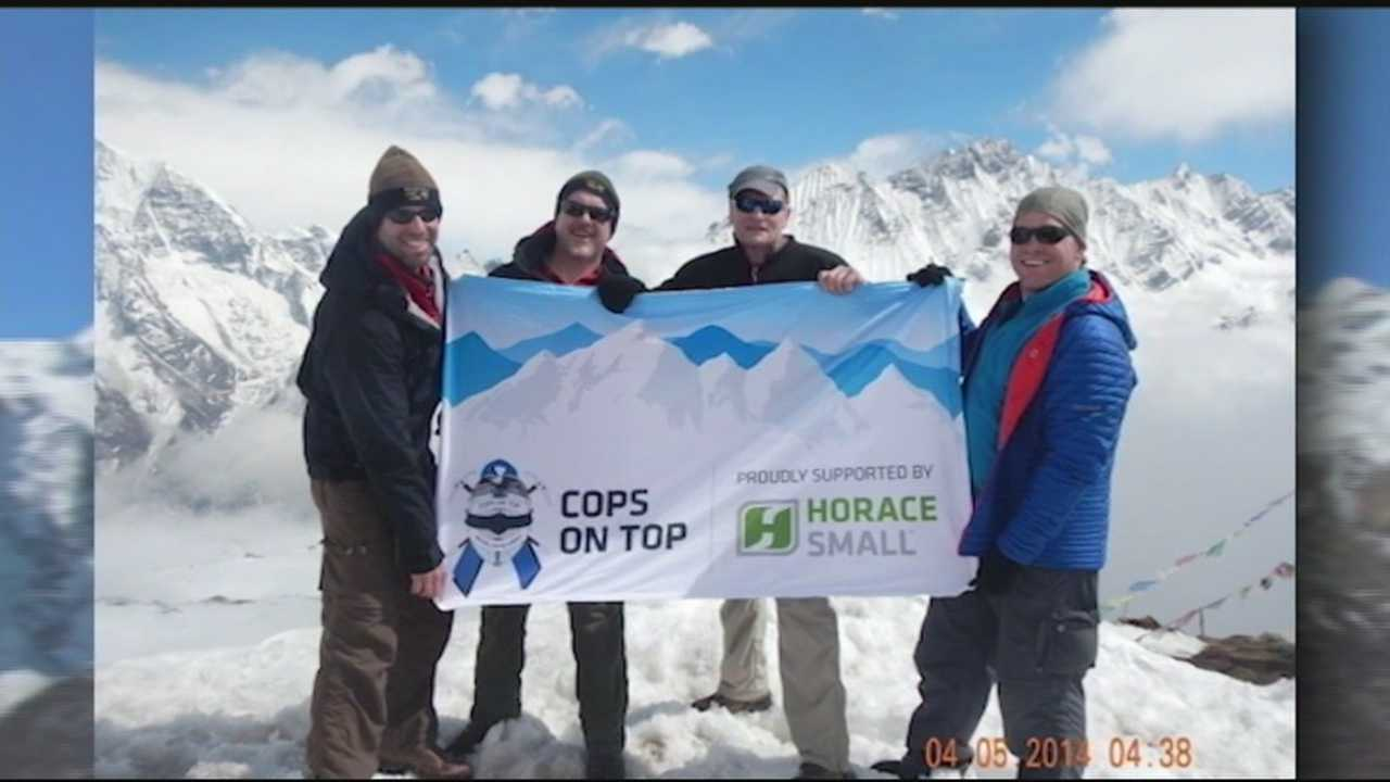 Hikers fly flag on Nepalese peak