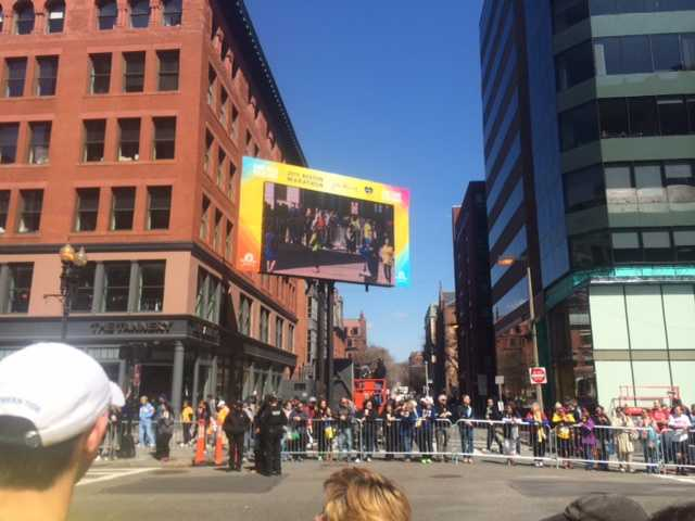 A large screen on Boylston Street captured 5K runners heading for the finish line Saturday.