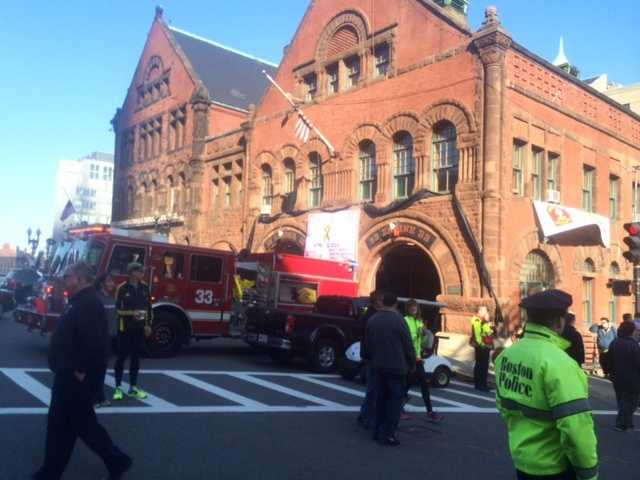 The Boston Marathon 5K route went past Engine 33, where two of their firefighters were killed battling a fire on nearby Beacon Street. Firefighters saluted runners.