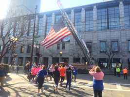 A Boston Fire Department ladder truck displayed the flag on the marathon route.