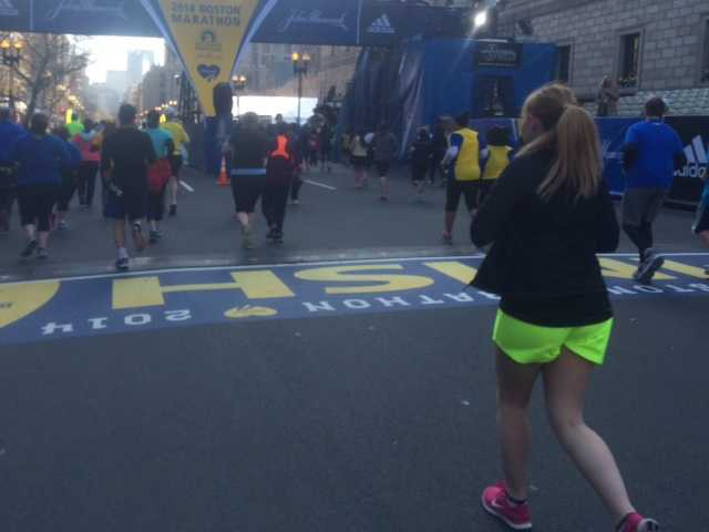 Runners cross the finish line.