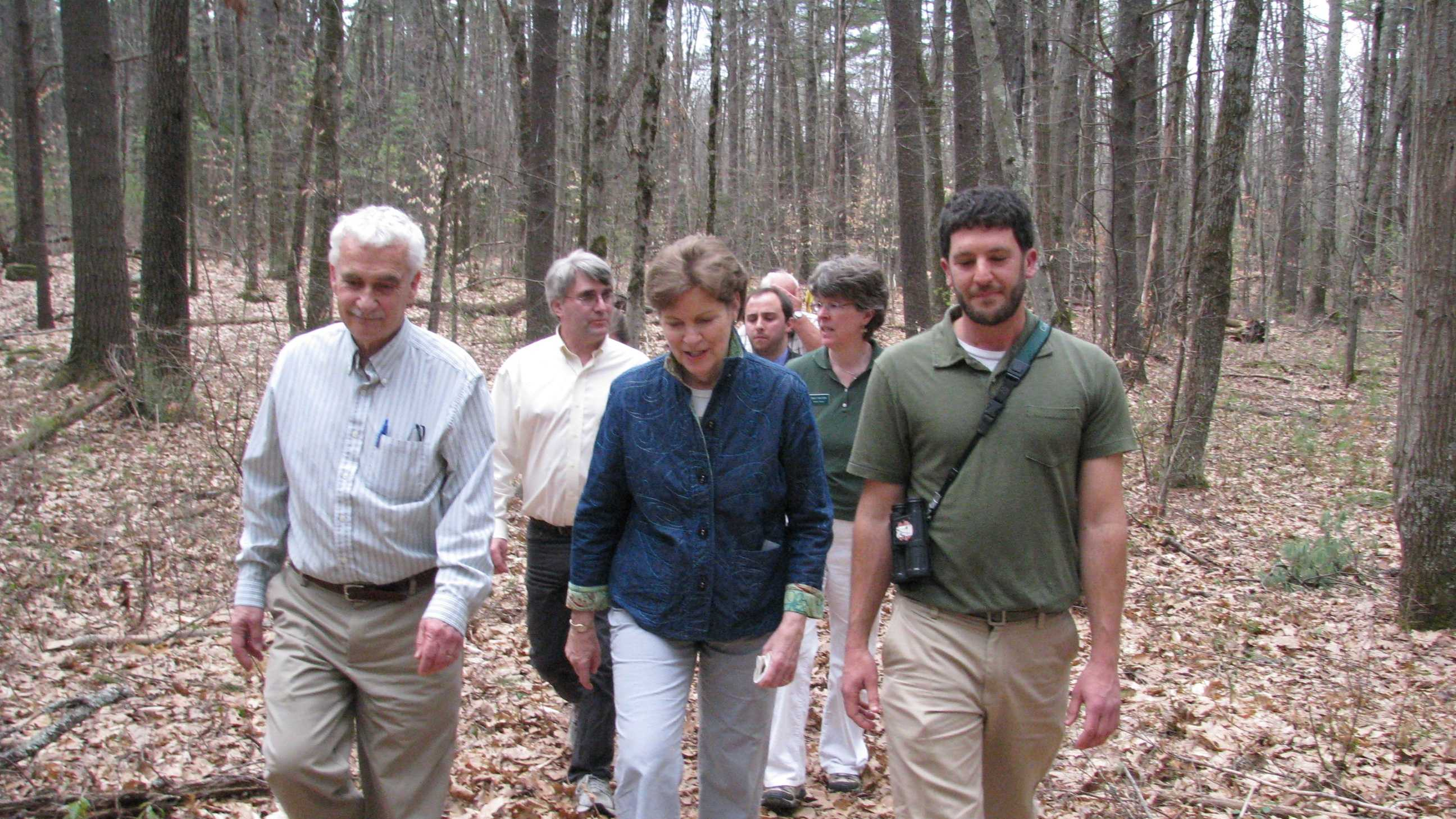 U.S. Sen. Jeanne Shaheen and conservationists walk the trails at the NH Audubon's McLane Center, Tuesday, during Earth Day and following a discussion on the impacts of climate change on the region.