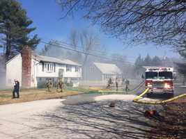 Fire crews are dealing with extremely windy conditions while fighting a fire at a home on Faith Lane in Manchester Thursday afternoon.