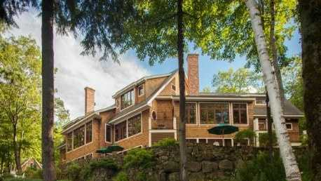 1163 Route 103 in Newbury is almost 8,000 square feet situated directly on Lake Sunapee.