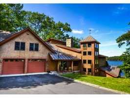 It offers lakefront views, and includes a dock, deck and screen porch.