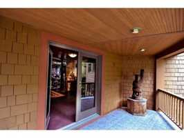 The property features an open floor plan, cathedral ceilings and stone fireplaces.