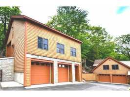 There is a multi-level six-car garage to store all of your vehicles for the land and the lake.