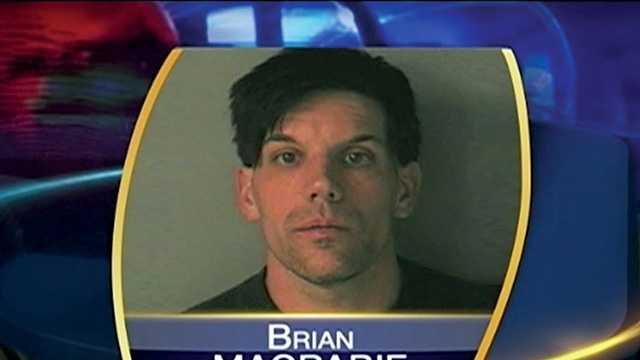 Man arrested after crashing into Merrimack homes