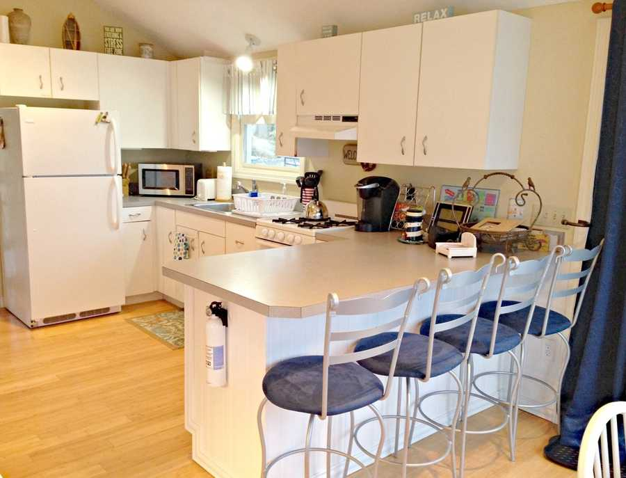 The kitchen is bright and updated and there is a lovely breakfast table facing the water.