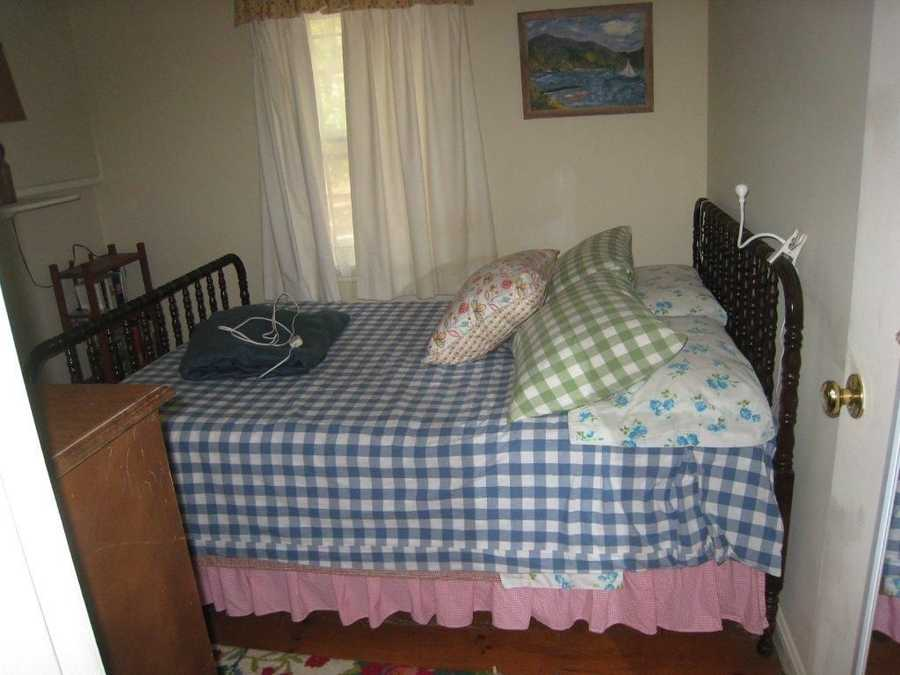 The cottage has one queen bed, one room with twin beds, and a porch with a pull-out sofa bed.