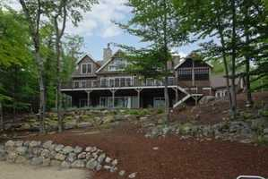 It sleeps 12. It has four bedrooms, six bathrooms, and is located at 27 South Winds Road in Moultonborough.