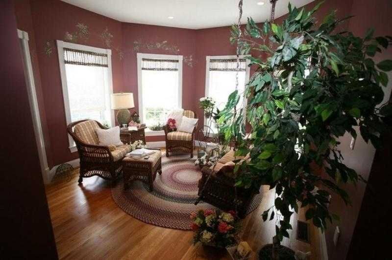 The home includes several cozy seating spaces like a living room, family room, den and library.